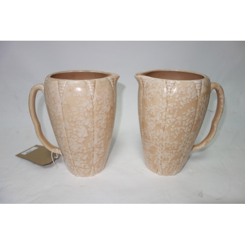 316 - A pair of Arthur Wood Art pottery jugs. H.20cm....