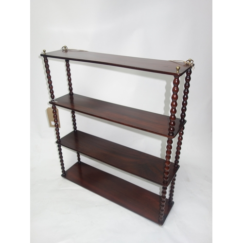 347 - A Victorian mahogany wall hanging shelf, with bobbin turned supports, H.73 W.64 D.17cm...