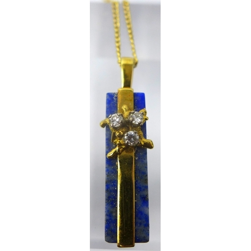 1128 - An 18ct yellow gold, lapis lazuli and diamond pendant on an 18ct yellow gold chain, Pendant: 30 x 6m...