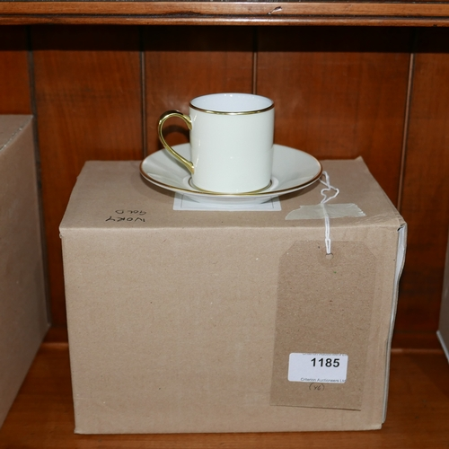 1185 - 6 Legle Limoges, porcelain coffee cups and saucers in ivory and 18ct yellow gold finish....
