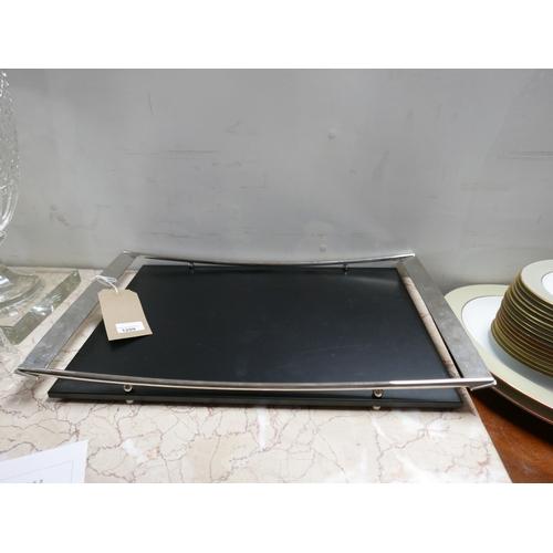 1209 - A Zanetto, chrome and black lacquered tray, H: 5cm, Dia: 56cm, RRP: £120....