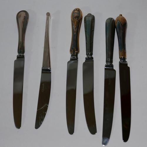 1211 - Three blocks of individual knives (ex display)- handles silver and gold plated....