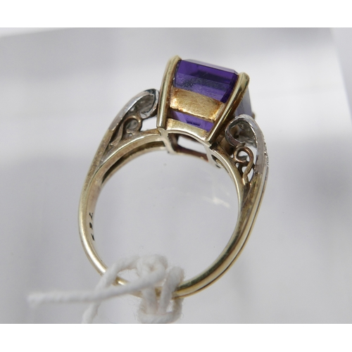 1109 - A 14ct yellow gold, diamond and amethyst ring, centrally set with a large, stepped cut, rectangular ...