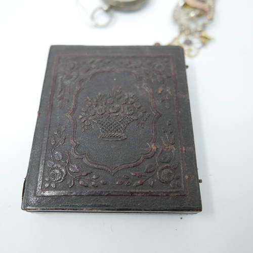 1114 - A 19th century, embossed brown leather box containg a WWI silver and rose gold pin 'Somme' badge 3.2...