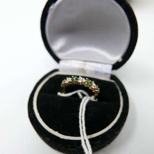 1023 - A boxed, 14ct yellow gold diamond and emerald ring, aternately set with a total of twelve emeralds a...