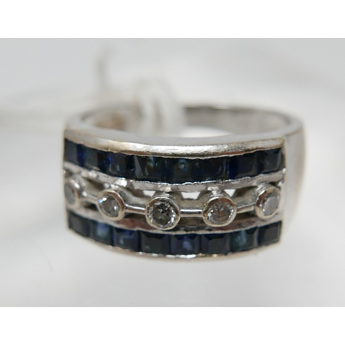 1013 - A large, 18ct white gold Art Deco style diamond and sapphire ring, set centrally with five, round, b...
