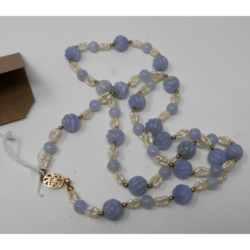 1112 - A Chinese, yellow metal clasped and beaded necklace strung with freshwater pearls and carved, lilac-...