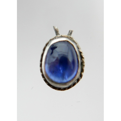 1099 - A single natural sapphire cabochon set into an antique silver mount, Cabochon: 5 x 4mm, 0.4g...