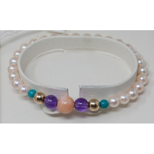 1086 - A cased and boxed, 9ct yellow gold, pearl, turquoise, amethyst and coral bracelet, Dia: 8cm, 8.5g...