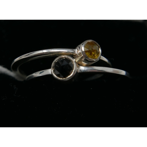 1016 - Two boxed, sterling silver rings set with one faceted yellow and one black diamond, Sizes: P & Q 1/2...