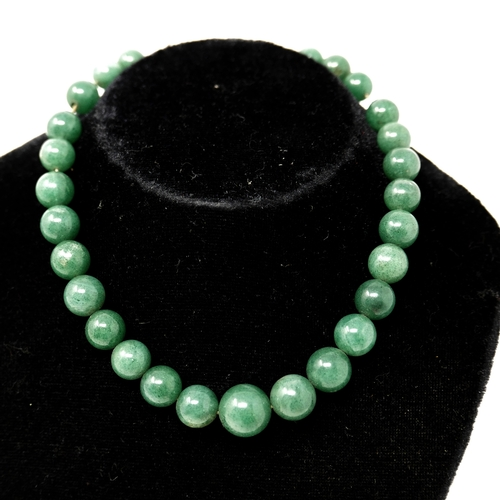 1124 - An antique, green hardstone, graduated bead necklace, L: 33cm, Largest bead: 2.3 x 1.3cm, 55g...