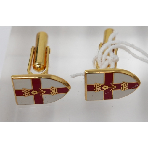 1032 - A pair of 9ct yellow gold, City of London Guild armorial cufflinks in red and white enamel, 8.1g...