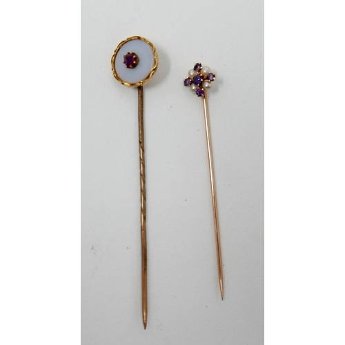 1031 - Two, Victorian, yellow gold stick pins: circular white agate and ruby example L: 6.5cm and amethyst ...
