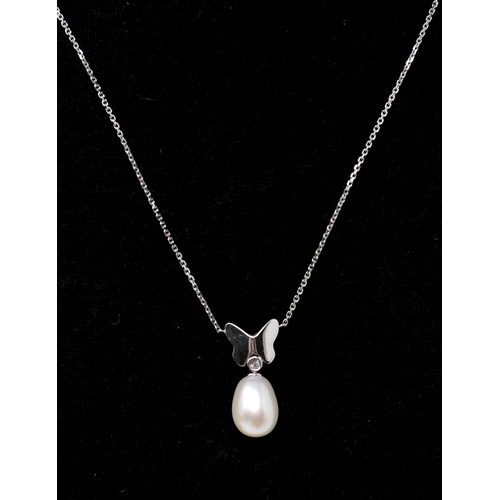 1122 - A boxed, 18ct white gold, diamond and pearl pendant with 18ct white gold butterfly motif on an 18ct ...