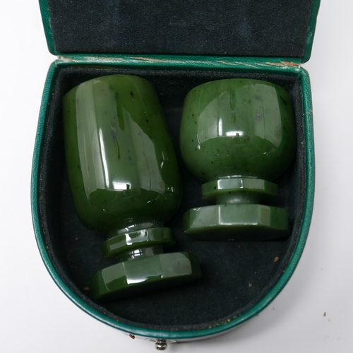 1103 - Two nephrite green jade liqueur cups having hand-carved faceted bases and stems, H: 7.5cm Dia: 3.5cm...