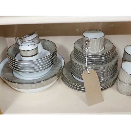 1164 - A large collection of Legle Limoges, grey and white porcelain crockery, platinum finish (plates, mug...