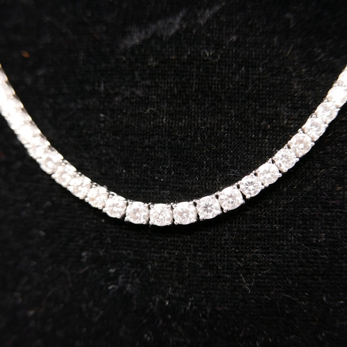 1000 - A boxed, 18ct white gold graduated diamond necklace of 18.05 carats set with a total of 125 round br...
