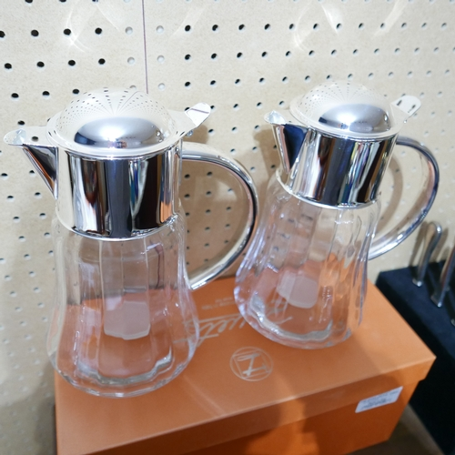 1199 - A boxed, pair of Zanetto, 'Angie' silver-plated and glass pitchers, H: 28cm....