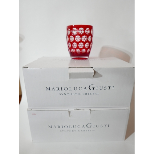 1245 - Two boxes of 12 Marioluca Giusti, Italian, 'Synthetic Crystal' red textured plastic beakers. H: 11cm...