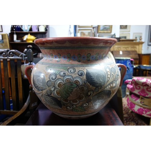 189 - A large 20th century hand painted twin handled terracotta pot, H.42 W.60 D.48cm...