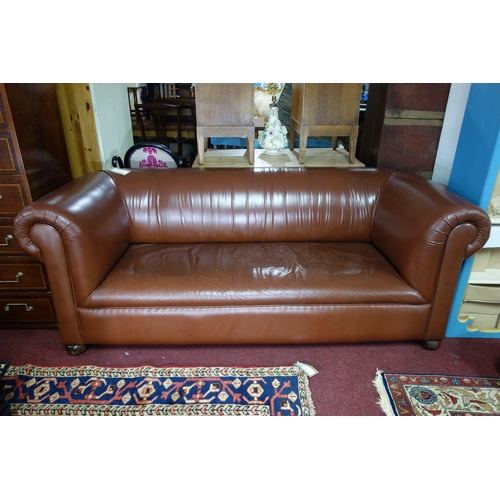 268 - An Edwardian brown leather chesterfield sofa, raised on castors, H.75 W.191 D.88cm...