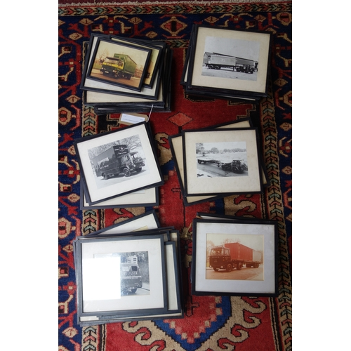 362 - A large collection of framed photographs of vintage trucks (39)...