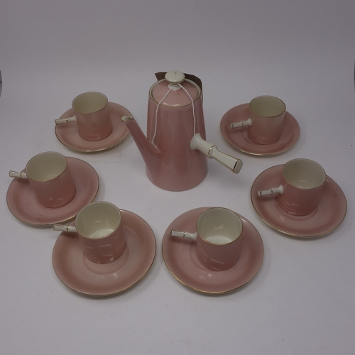 368 - A pink Victoria Czechoslovakia porcelain part coffee set, comprising hot water pot, 6 coffee cups an...