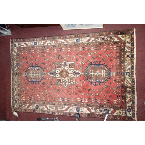 72 - A North West Persian Heriz rug, triple pole medallion with repeating petal motifs on a terracotta fi...