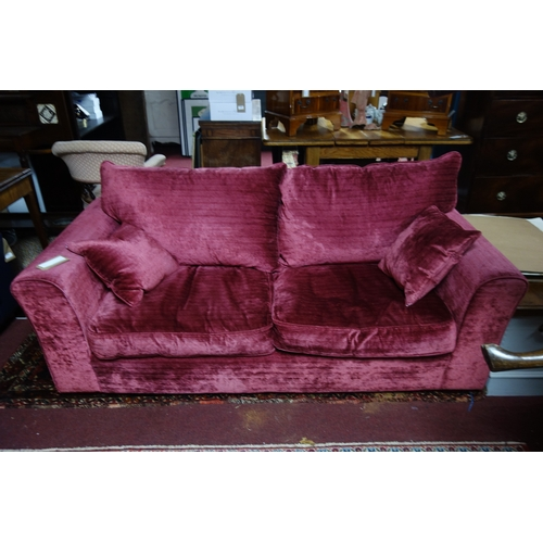 136 - A Heals Red velvet two seat sofa...