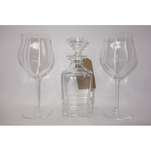 14 - A St Louis crystal decanter, H.22cm, together with a pair of St Louis crystal wine glasses with indi...