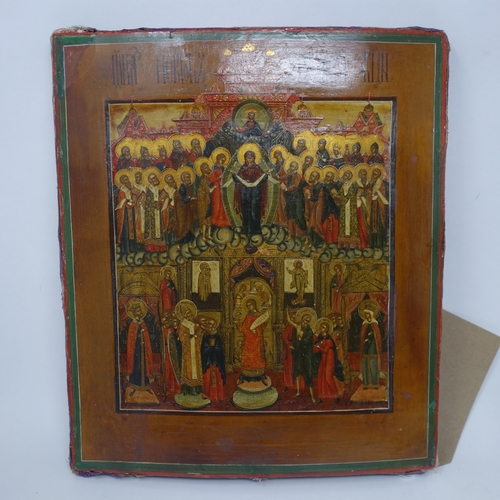 18 - A Russian icon of The Pokrov Mother of God, tempera on wood panel, parcel gilded, 31 x 27cm...
