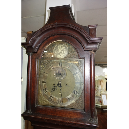 23 - An 18th century oak longcase clock by Nathaniel Hedge of Colchester, twin train movement, striking b...