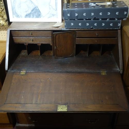 279 - A 19th century oak bureau with four drawers raised on bracket feet, H.100 W.90 D.48cm...