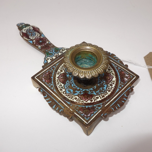 32 - A French enamel chamberstick, polychrome decorated with scrolling foliage, on shaped square base and...