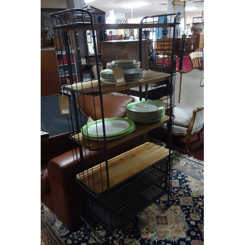 322 - An industrial trolley rack, four shelves and three drawers, raised on castors, H.160 W.31 D.80cm...