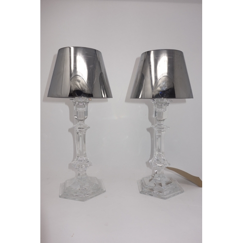 69 - A pair of Baccarat crystal table candle holders in the form of lamps, by Phillipe Starck, H.33cm, in...