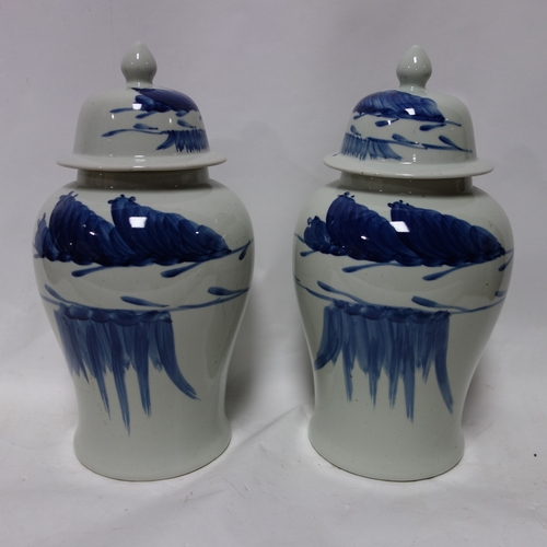 223 - A pair of Chinese temple jars and covers, H.50cm (2)...