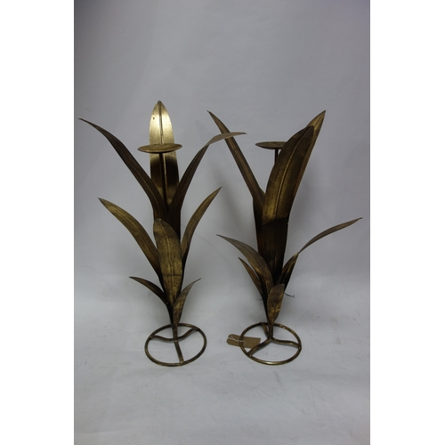 252 - A pair of gilt metal floral design candle holders, H.84cm (2)...