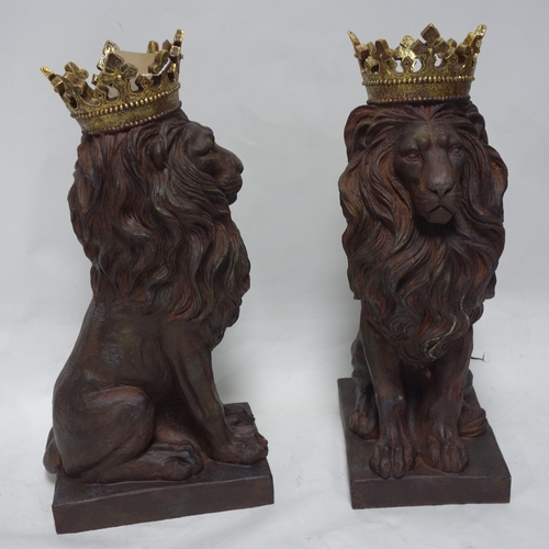 302 - A pair of resin lions with gilt painted crowns, H.55cm...