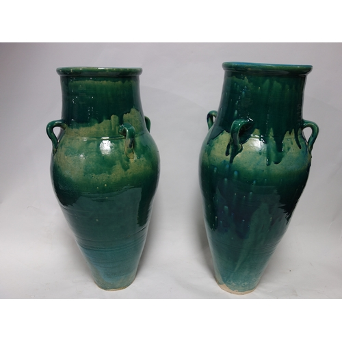 94 - A pair of Persian turquoise glazed Sharab wine vessels, H.74cm (2)...