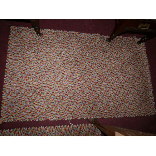185 - A John Lewis rug with multi beans design, 136 x 80cm...