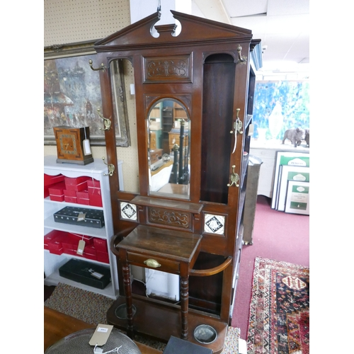 213 - An Arts & Crafts mahogany hall stand...