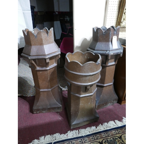 214 - A pair of Victorian chimney pots, H.100cm together with one other...