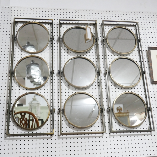 219 - Three bronzed mirrors, each with three circular mirrors, 90 x 31cm...