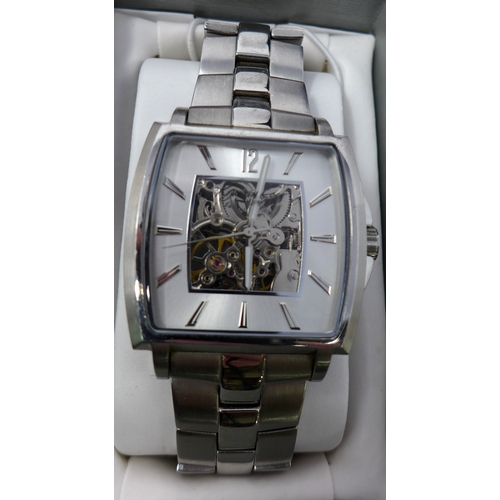 42 - WITHDRAWN- A Kenneth Cole gentleman's stainless steel wristwatch, skeleton dial with baton markers a...