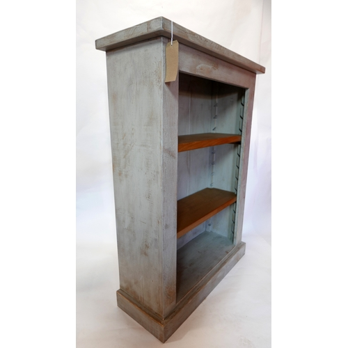222 - An Indigo distressed painted bookcase with adjustable shelves, raised on stepped base, H.127 W.92 D....