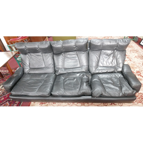 162 - A 1970's black leather sofa by Jacques Charpentier for Roche Bobois...