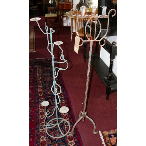 364 - An iron candelabra, H.123cm together with one other...
