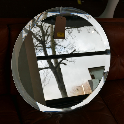 53 - A large circular bevelled glass wall mirror, Diameter 60cm...