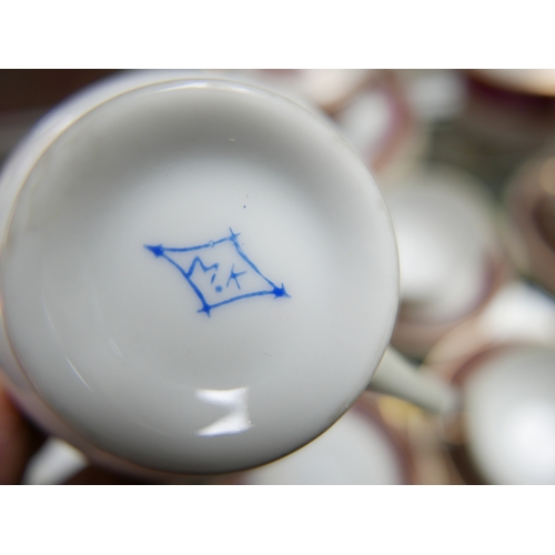 172 - A part porcelain tea service marked M.K, handle on tea pot broken...